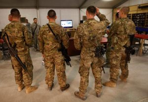 More US military troops watch the President speak