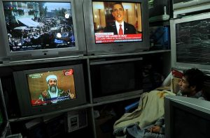 People sit glued to TV sets as channels across the world run the breaking news.
