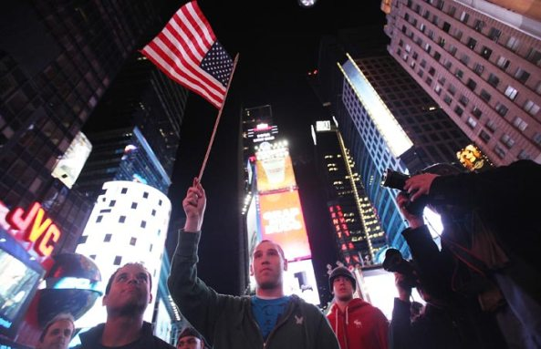 People gather in Times Square on May 2, 2011 shortly after the announcement from US President Barack Obama that Al Qaeda mastermind Osama bin Laden was dead